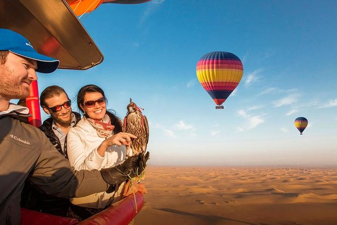 Hot Air Balloon Ride over Dubai Desert, Breakfast, Falcons & 1950s Land Rover