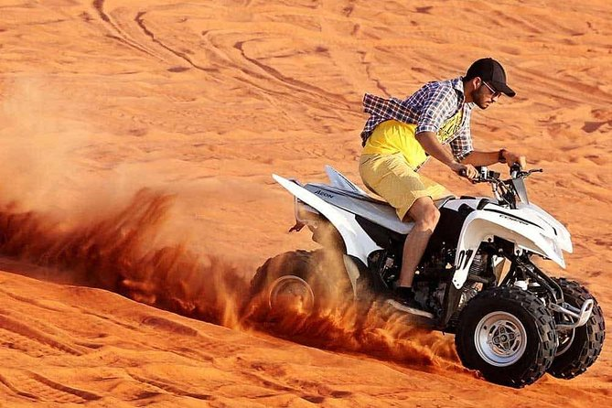 Dubai Self-drive Quad Bike,Sand Boarding,Camel Ride and Refreshments at Camp