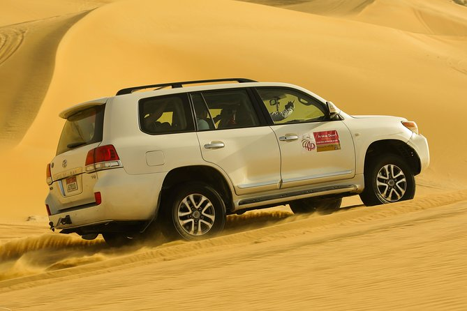 Abu Dhabi Morning Desert Safari with 4×4 Dune Bashing & Camel Riding