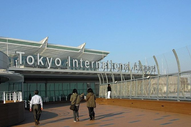 Transfer from HND Airport to Tokyo by Private Car for Nighttime Flight