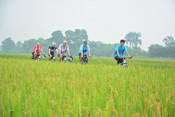 Electric biking tour to outskirt of Hanoi, culture,drinks,local lifestyle