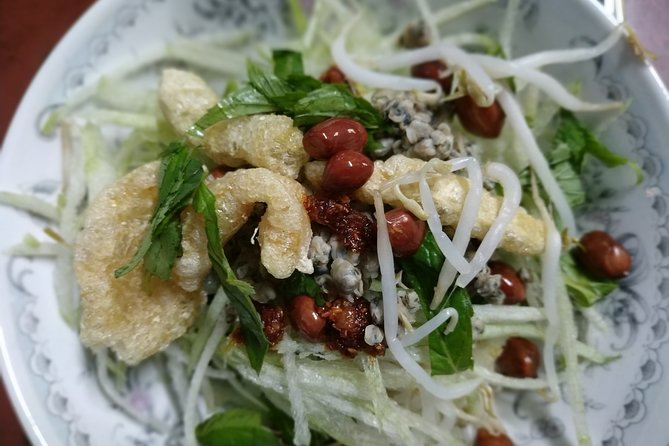 Cơm Hến- Clams Cooked Rice- a typical taste of Hueish. The dish is served as a salad of baby claim mixed with a variety of different vegetables and Hue spices