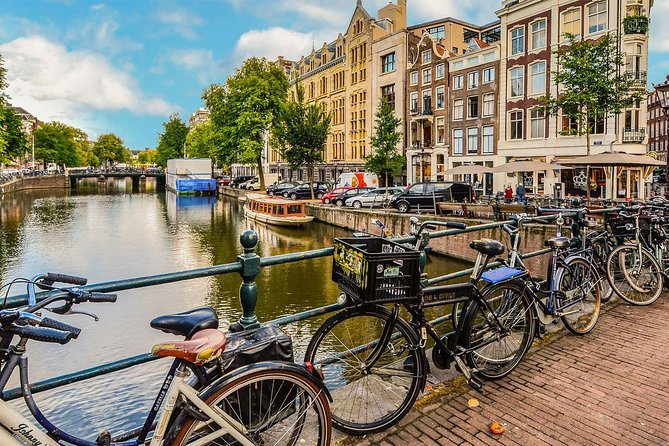 Brussels <-> transfer to or from Amsterdam (city or airport, private)