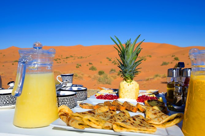 Merzouga: Overnight in Royal Desert Camp with Camel Ride, meals & sandboarding