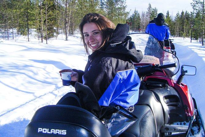 Snowmobile Safari in the Forest