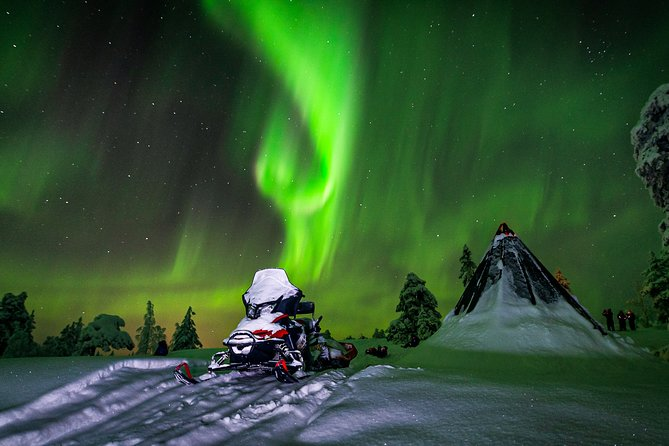 Hunting Northern Lights by Snowmobiles