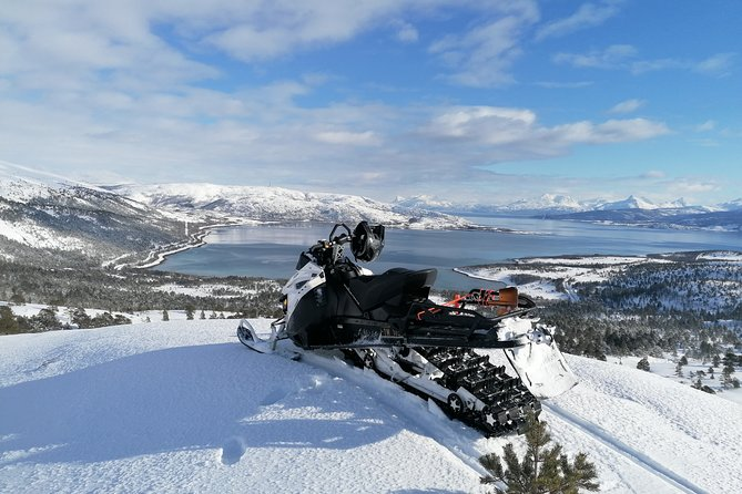 Guided snowmobile tour to Holy Mountain wigwam
