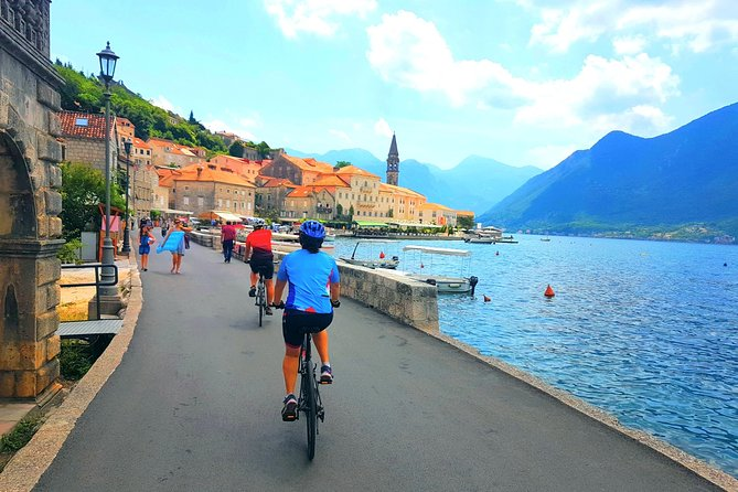 Cycling Kotor Bay circle 45km, visit Our Lady of the rock church on island.