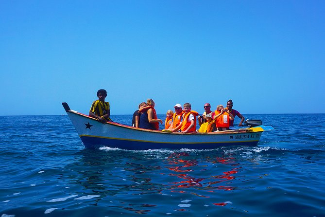 Santiago Island: Boat Trip to the Cave, Snorkeling and Barbecue on the beach
