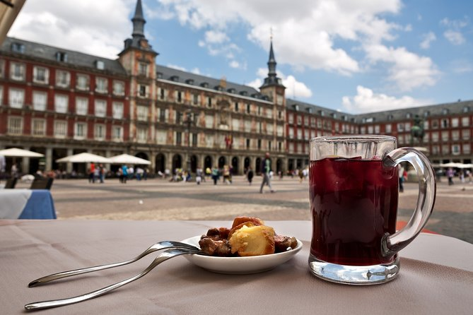 Spanish cuisine masterclass in Madrid: local market, wine tasting & tapas tour
