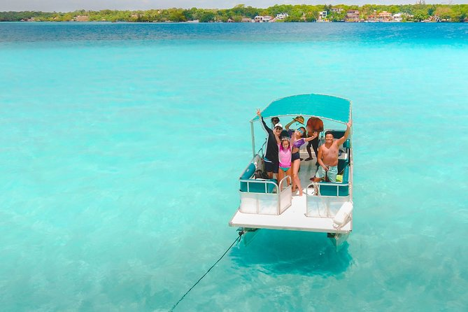 Full day tour to BACALAR Seven Colors Lagoon, Cenotes and Sujuyha Clay Park