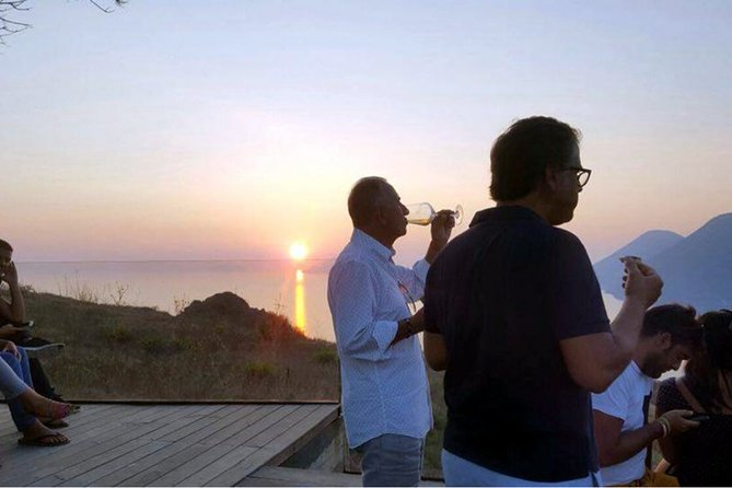 Tasting in the vineyard at sunset