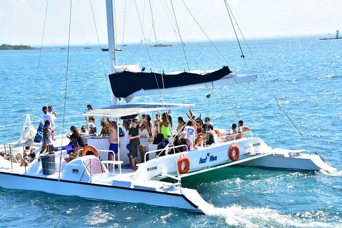 Catamaran to Isla Mujeres, snorkel + beach club