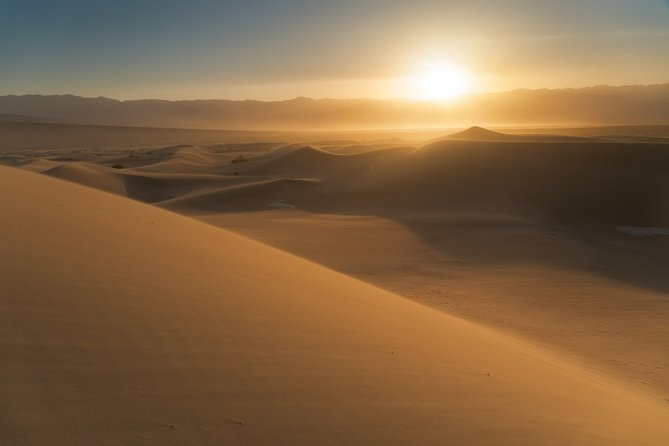 Exclusive Sunrise Desert Safari with Sand Boarding and Camel Ride