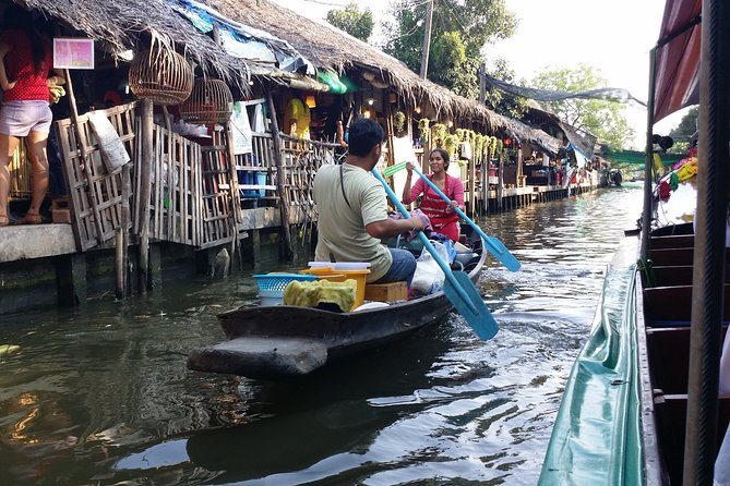 Risky market,boat riding,Ampawa floating market