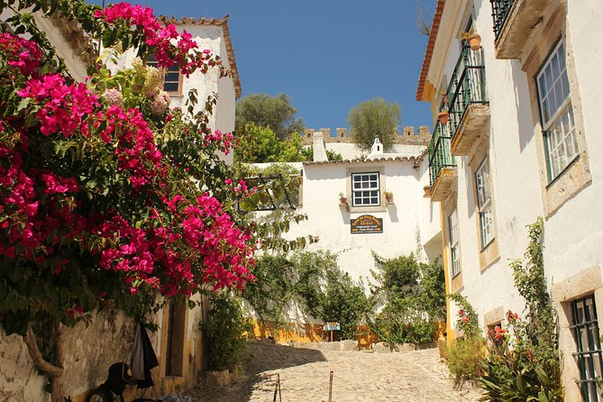 From Lisbon: Private Tour to Obidos, Nazare and Fatima with Drop-off in Porto