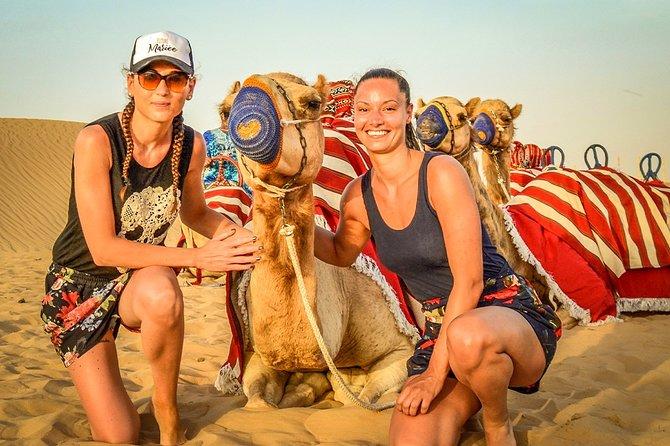 Dubai Morning Quad Bike with Sandboarding and Camel Ride