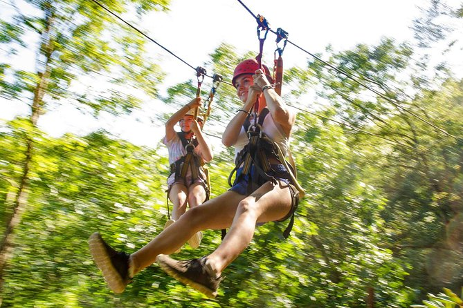 IRRESISTIBLE Jungle Adventure driving your own ATV. Ziplines and Cenote included