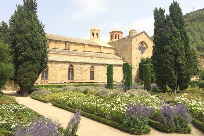 Tour to Lagrasse village & Fontfroide Abbey. Shared tour from Carcassonne.