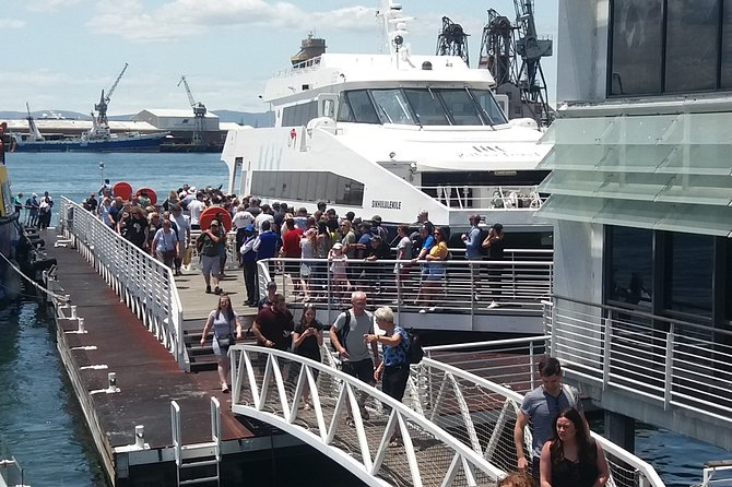 Travelers board the ferry