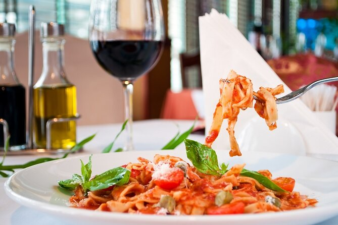 Cooking class of delicious Italian specialities with wine tasting