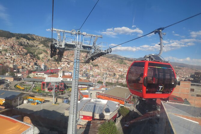 From La Paz: Cable car ride tour with tasting food.