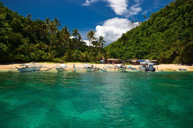 Puerto Galera Island Hopping and Snorkeling with Unlimited Lunch and Drinks