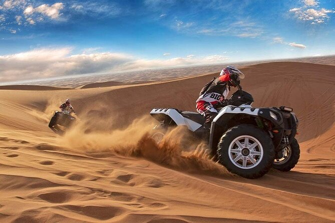 Half-Day Red Dunes by Quad Bike with Camel Ride and Sandboard