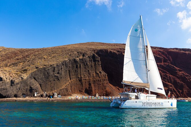 Private Catamaran Sailing in Santorini with BBQ Meal and Drinks