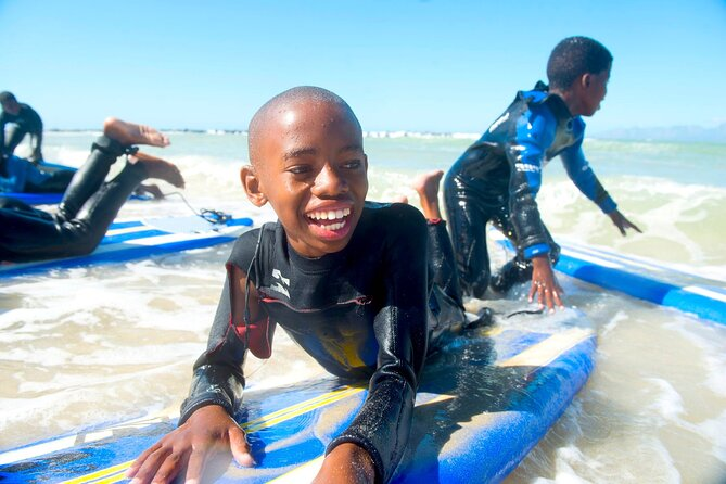Surf Lesson w/ NGO Kids add-on