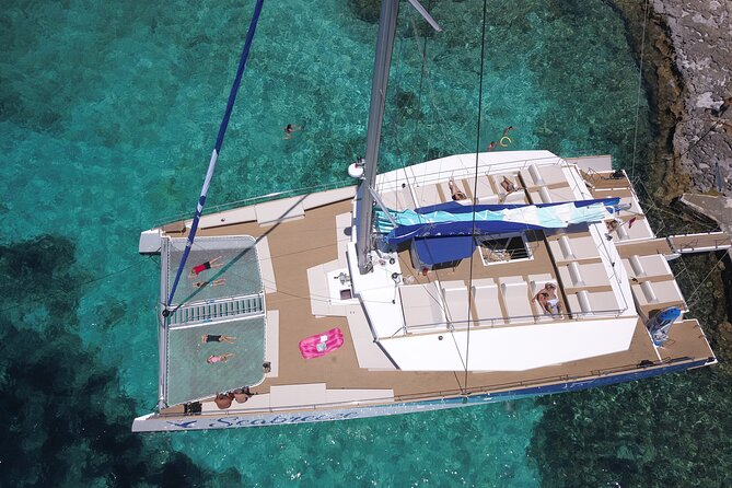Discover the best beaches & bays on the Sea Breeze a catamaran under sail