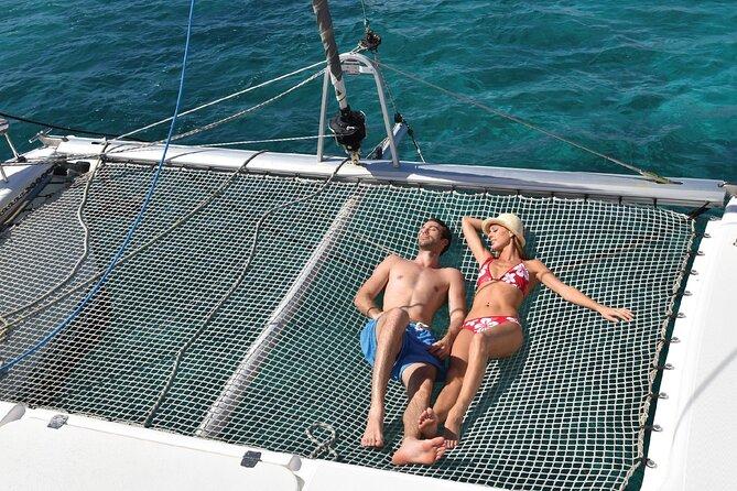 Enjoy a unique Catamaran adventure to Isla Mujeres & at Spectacular Night Show