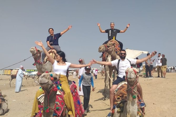 Private Half Day Tour to Giza Pyramids with Camel Ride and Lunch