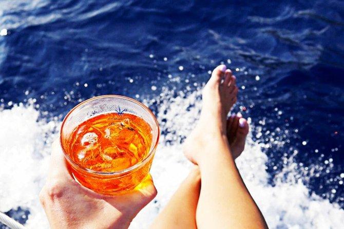 Sabaudia: Sunset boat tour with aperitif
