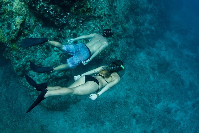 Two-Stop Snorkel Sail with Picnic Lunch & Open Bar at Ritz-Carlton