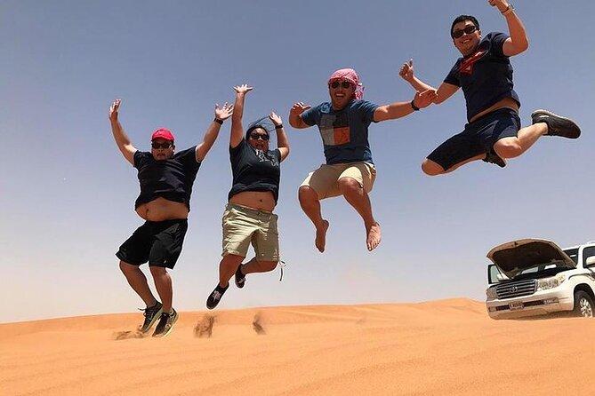 Enjoy The Dubai Fossil Rocks Desert with Sandboarding, Camel Ride,& BBQ Dinner