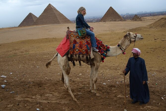 Half Day tour to Giza Pyramids with Camel ride and lunch