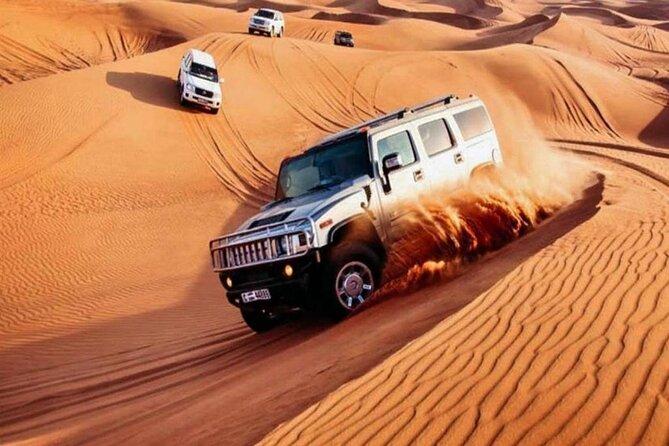 Best Desert Safari with BBQ Dinner,Belly Dance,Camel Riding & Sand Boarding