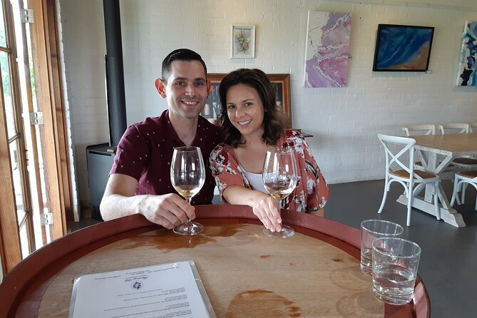 A couple enjoying a tasting at Blueberry Hill Estate