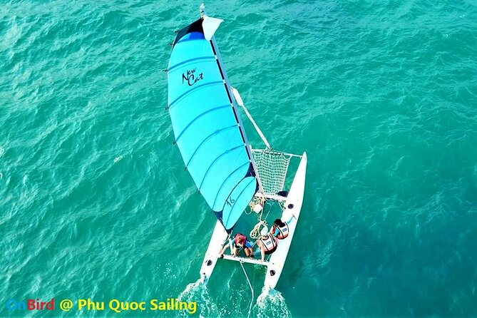 OnBird - Sailing to Turtle Island by Catamaran & Sunset at Casuarina Beach