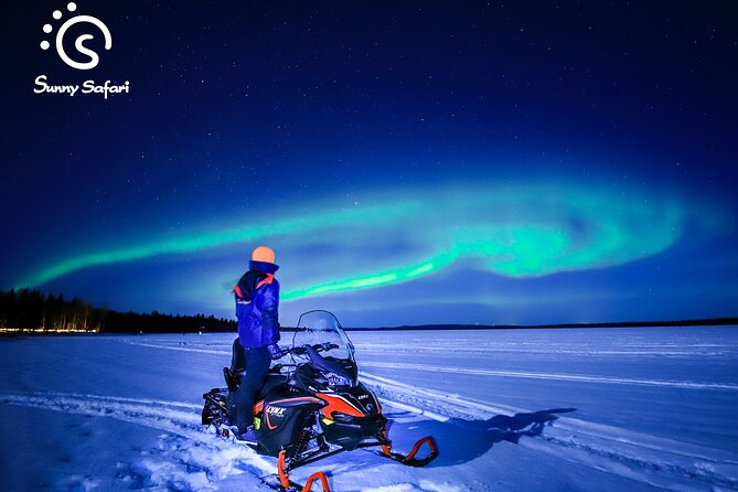 Searching Aurora With Snowmobile