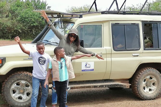 Clients at a picnic site having a photo session in masaai mara