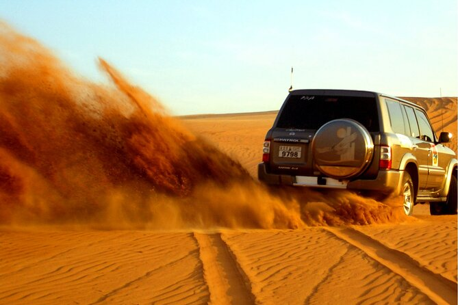 Dubai Desert Safari & BBQ Dinner with Live Belly Dance,Fire Show, Tanura Show