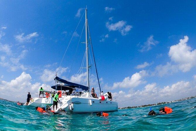 Catamaran sailing away to the Island, Isla Mujeres.