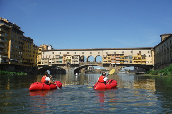 Kayak on the Arno river in Florence under the Old Bridge