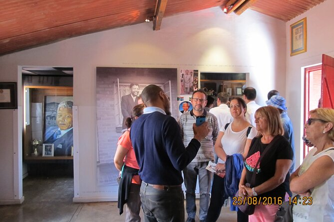 Inside the Mandela House museum in Soweto with Ruben the guide who speaks Portuguese, Spanish and English.