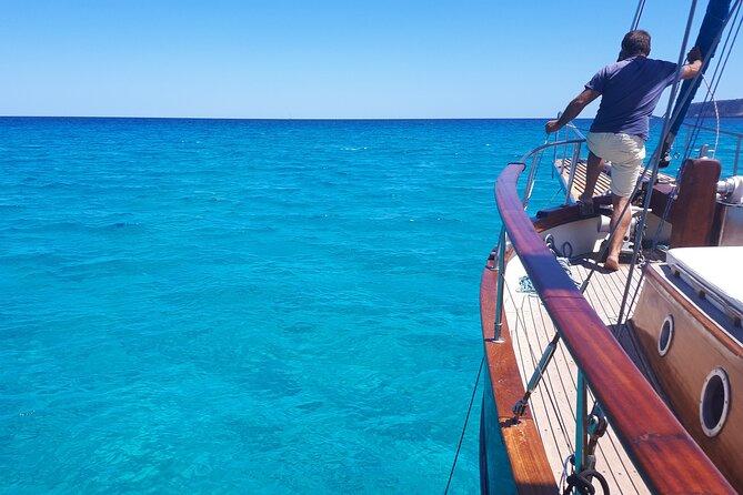 Sail through Ibizan waters aboard a classic sailboat