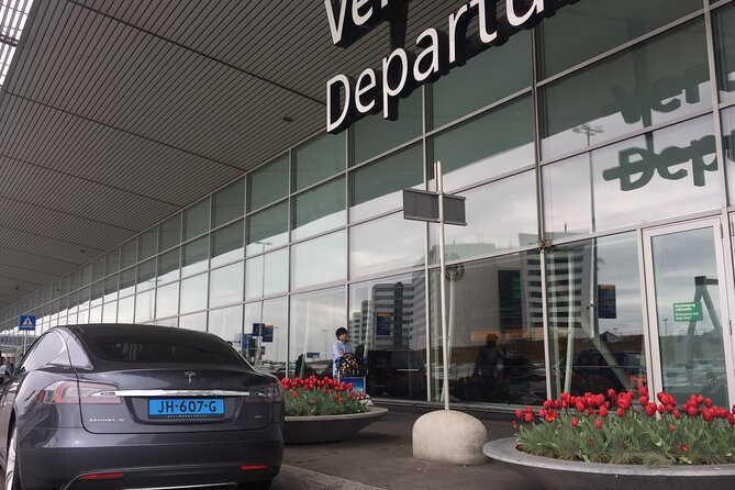 Zero Emission Tesla Taxi Transfer from The Hague to Schiphol Airport