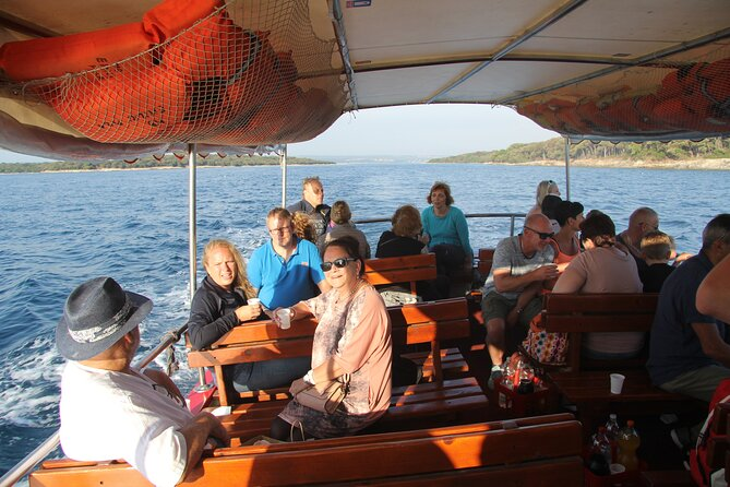 Dolphin Watching Sunset Boat Trip in Pula with Dinner