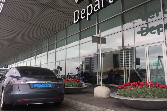 Private Tesla Taxi from Delft to Schiphol Amsterdam Airport